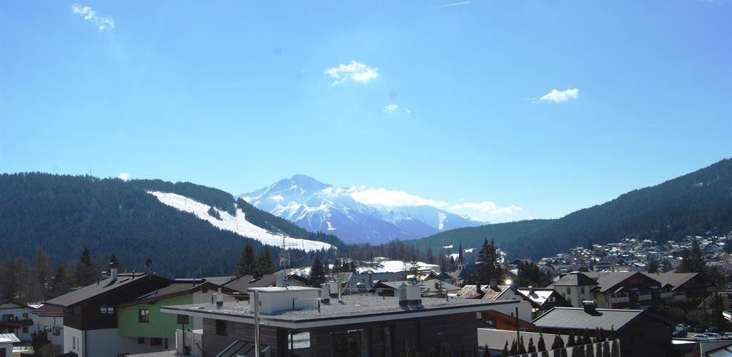 expansive view from the balcony of the alps and seefeld
